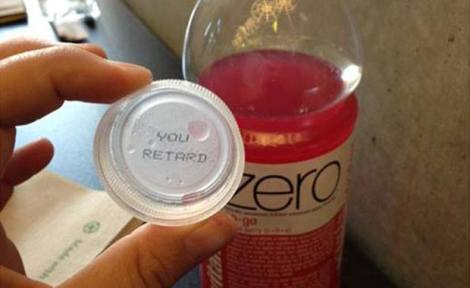 offensive message under her VitaminWater bottle cap.