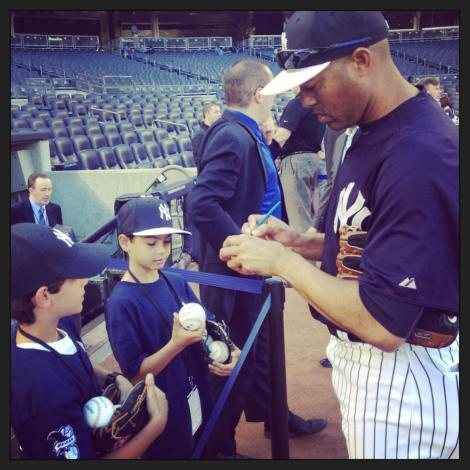 Mariano Rivera signs for young #Yankees fans before tonight's game