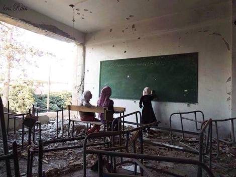 Students at a class .........in what is left of a school
